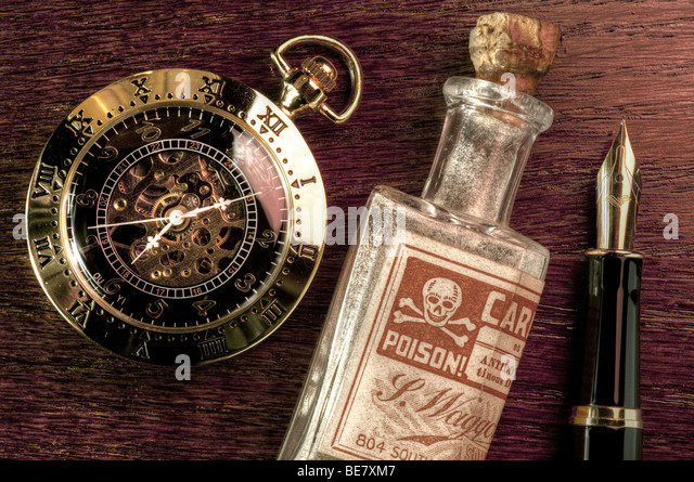 Pocket watch, fountain pen and a bottle of poison - Stock Image