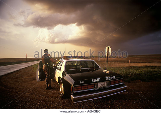 State Trooper Oklahoma Storm Spotter watching developing tornado producing storm near laverne Oklahoma - Stock Image