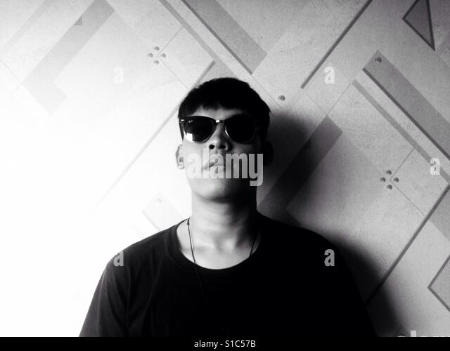 The Face of Asian Man With Sun Glasses on Black and White - Stock-Bilder