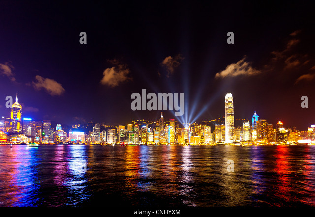 Skyline of Victoria Harbour at night, Hong Kong - Stock Image