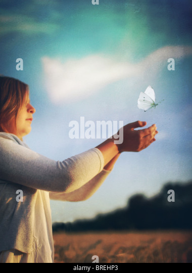 girl releasing butterfly - Stock-Bilder