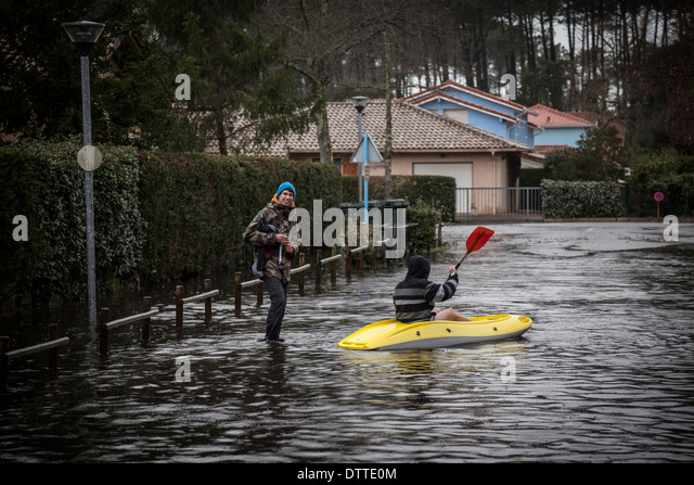 In Capbreton (Landes - France), boating on a flooded street. All opportunities are good for youngish people to have - Stock Image