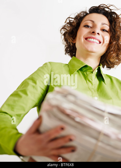 woman holding newspapers for recycling. Copy space - Stock-Bilder