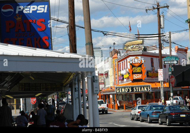 Urban Scene of Landmark Rival Philadelphia Cheesesteak Vendors Pats and Genos - Stock Image