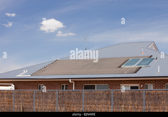 Solar water heaters on a house roof near Echuca, Victoria, Australia. - Stock Image