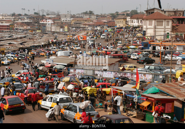 Traffic passing the very busy Kejetia Market in central Kumasi. Ghana. West Africa. ©Picture Zute Lightfoot. - Stock-Bilder