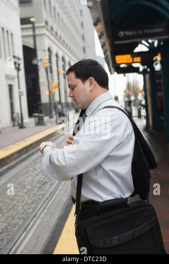 Businessman commuting to work - Stock Image