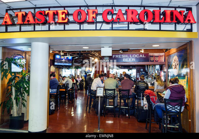 North Carolina Charlotte Charlotte Douglas International Airport CLT terminal concourse gate area restaurant front - Stock Image