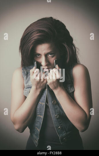 Scared young woman - Stock Image