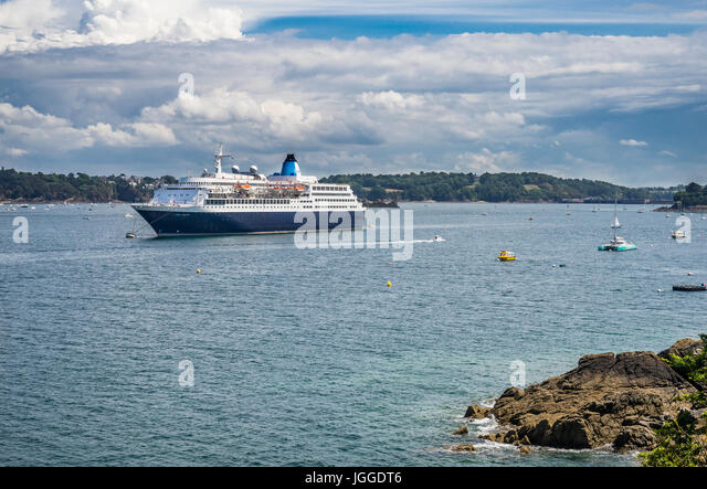 France, Brittany, Dinard waterfront, view of cruise ship Saga Sapphire, moored on the River Rance - Stock Image