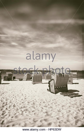 Covered beach chairs nostalgic summer wicker seat - Stock Image