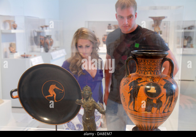 Tampa Florida Tampa Museum of Art gallery inside looking appreciating man woman couple urn vase classical - Stock Image