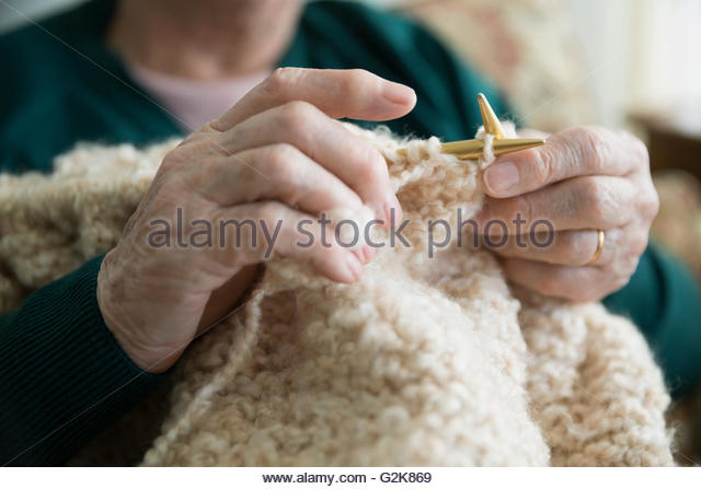 Close up senior woman knitting - Stock Image