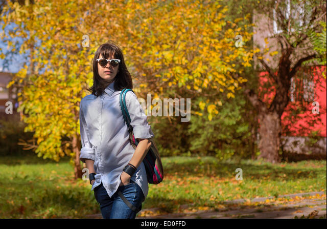 Portrait of young woman in autumn scenery - Stock-Bilder