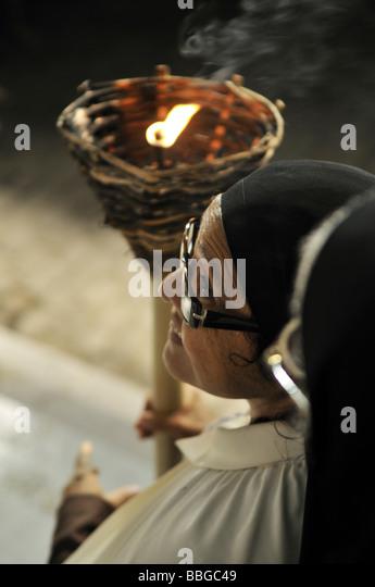 Nun with a torchlight on a Good Friday procession, Salvador, Bahia, Brazil, South America - Stock-Bilder