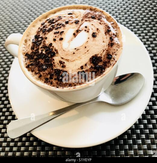 A cafe mocha coffee with a heart in the foam. - Stock Image