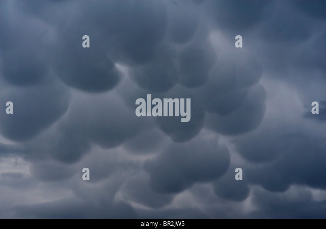 Mammatus or mammatocumulus, are meteorological terms applied to a cellular pattern of pouches hanging at the base - Stock Image