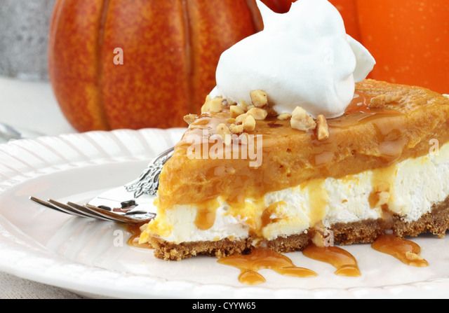 Slice of Double Layer No Bake Pumpkin Pie made with pumpkin, vanilla pudding,cream cheese, and whipped cream. - Stock Image