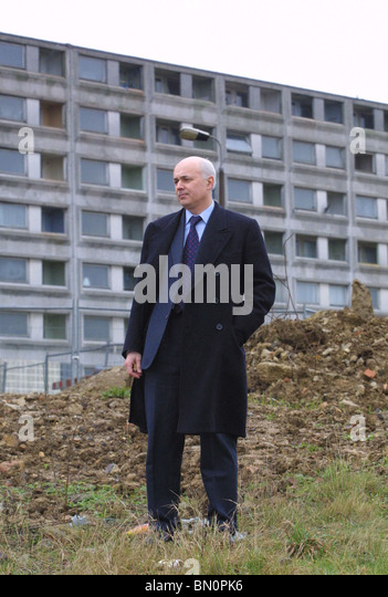 The Right Honourable  Iain Duncan Smith  MP by tower block - Stock Image