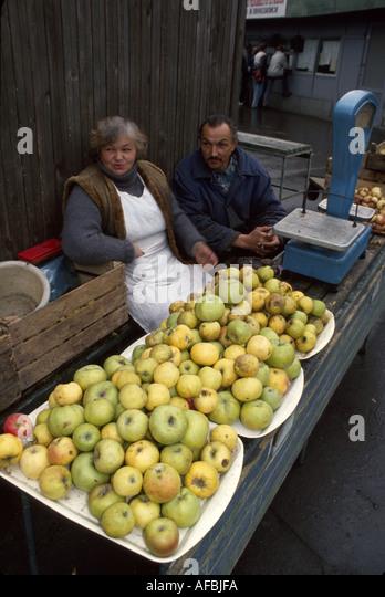 Latvia Riga produce vendors couple open market - Stock Image