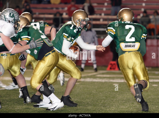 Faking a handoff in American Football - Stock Image