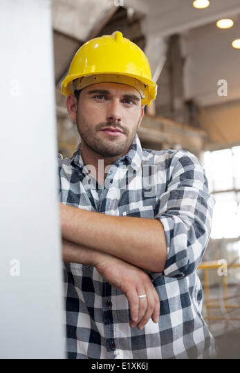 Portrait of confident young male worker in industry - Stock Image
