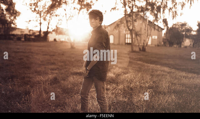 Teenage boy looking gloomy - Stock Image