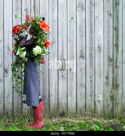 girl with red and green flowers - Stock Image