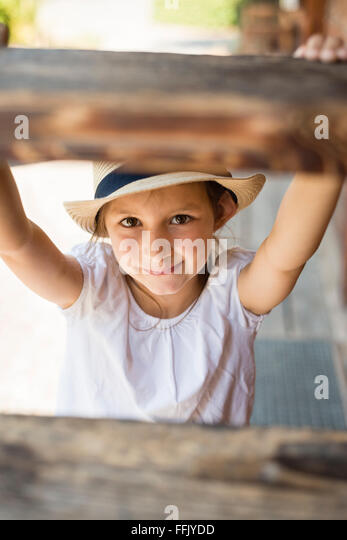 Portrait of little girl with sun hat - Stock Image