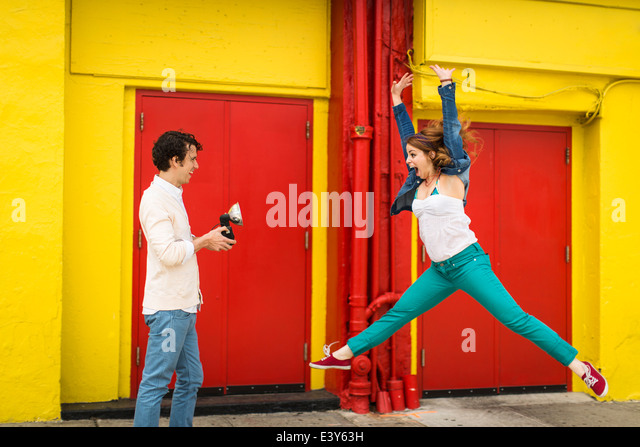 Couple having fun whilst taking photograph - Stock Image