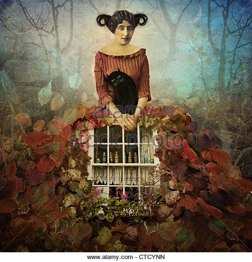 Cozy Autumn,Girl wearing leaf dress with a cat in her arms - Stock Image