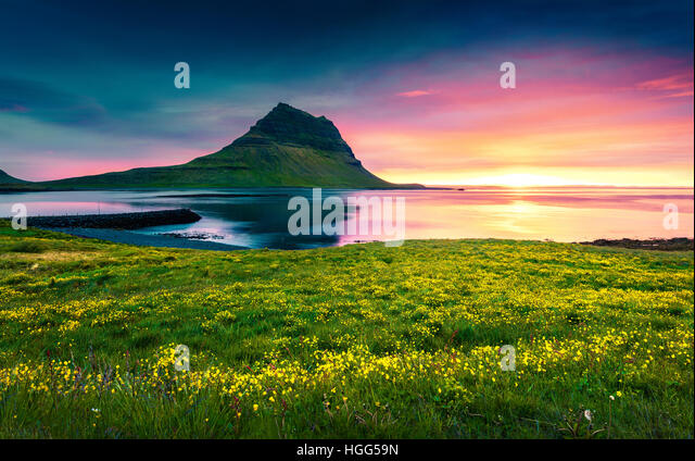 Summer sunset with Kirkjufell mountain. Dramatic scene on Snaefellsnes peninsula with fall of tide in Atlantic ocean,Iceland - Stock Image
