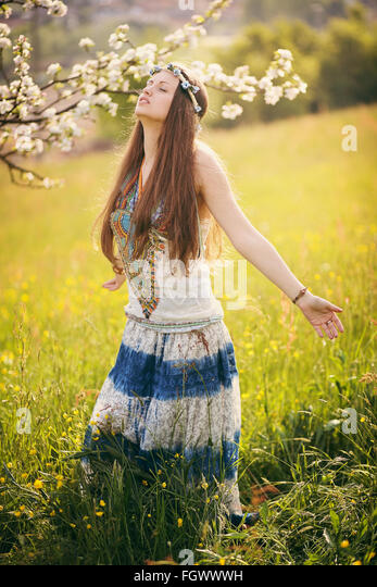 Beautiful free woman in a field. Nature and harmony - Stock-Bilder