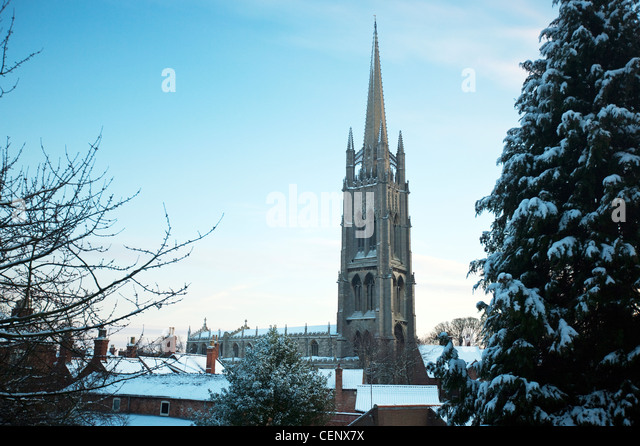 Snow, winter view of photo view of Parish Church of St James Louth Lincolnshire with late perpendicular steeple - Stock Image