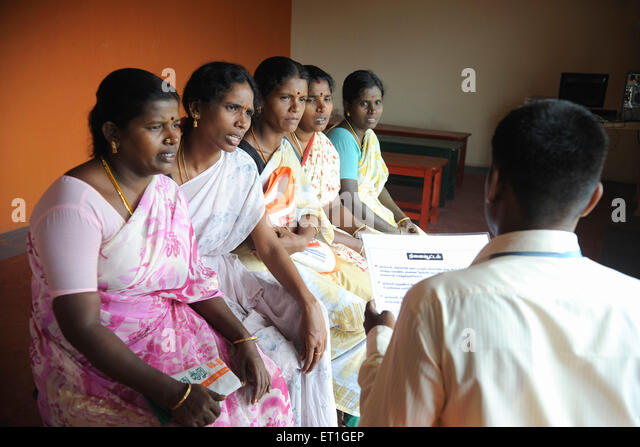 Rural ladies with volunteer of ngo kshtriya gramin financial services by IFMR foundation ; Thanjavur ; Tamil Nadu - Stock Image