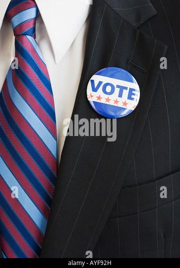 Vote pin on man's lapel - Stock Image