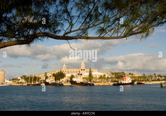Bermuda Dockyard Clocktower tugboats framed tree limb - Stock Image