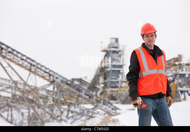 Engineer holding pipe wrench at a construction site - Stock-Bilder