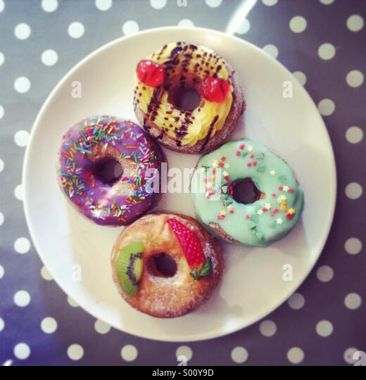 Cronuts, french mum and american dad - Stock Image