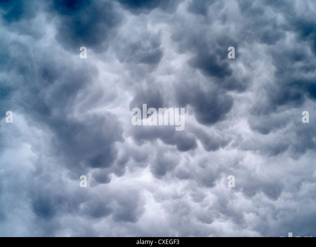Bowling ball clouds from an approaching thunderstorm. - Stock Image