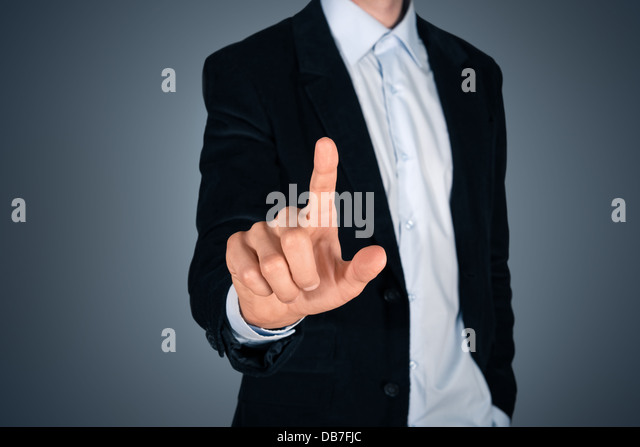 Portrait of handsome businessman touching a blank invisible screen. Touch screen concept image. Isolated on dark - Stock-Bilder