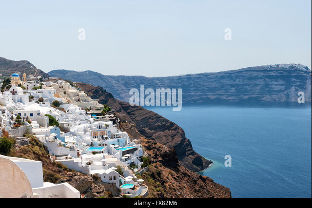 A panoramic stitch of Oia, Santorini island in Greece. - Stock Image