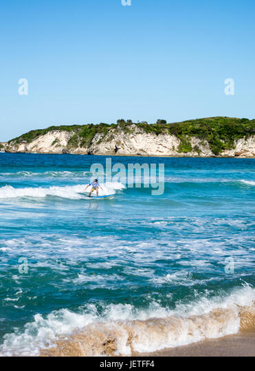 boy surfer on Macao beach in punta cana - Stock Image