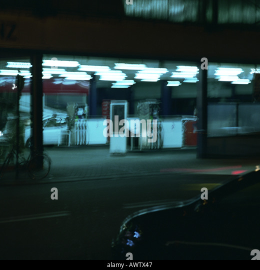 Service station at night, long exposure - Stock Image