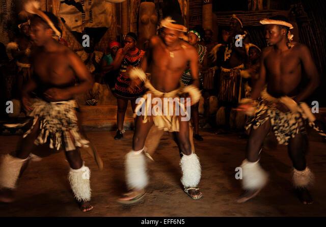 Group of 3 men performing traditional Zulu dance at Shakaland culture village Zululand South Africa Cultures Travel - Stock-Bilder