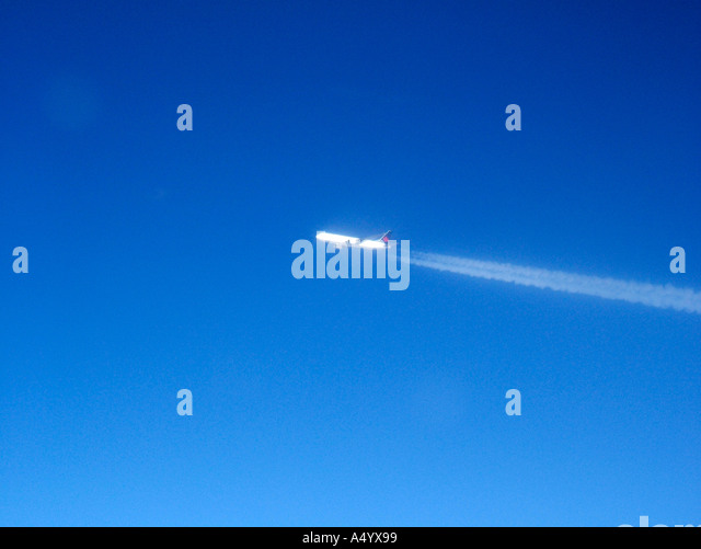 aeroplane with vapour trail - Stock Image
