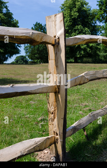 Hand carved wooden fencing in Sutton Park near Birmingham - Stock Image
