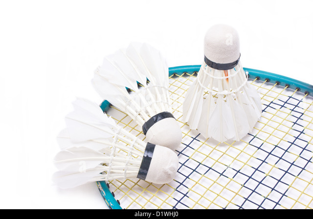 Shuttlecock with badminton racket isolated on white background. - Stock Image