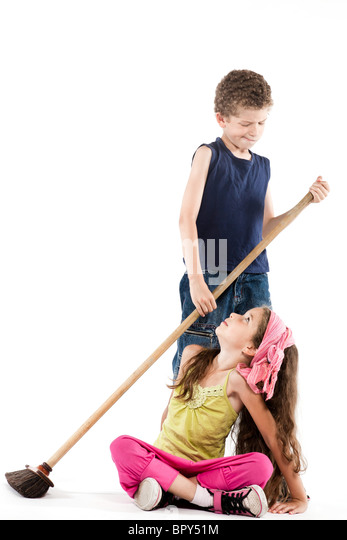 caucasian little boy sweeping angry little girl isolated studio on white background  jealousy concept - Stock Image