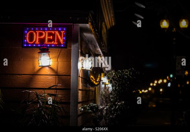 Open side lit up in the night in a small town with a old decor - Stock Image